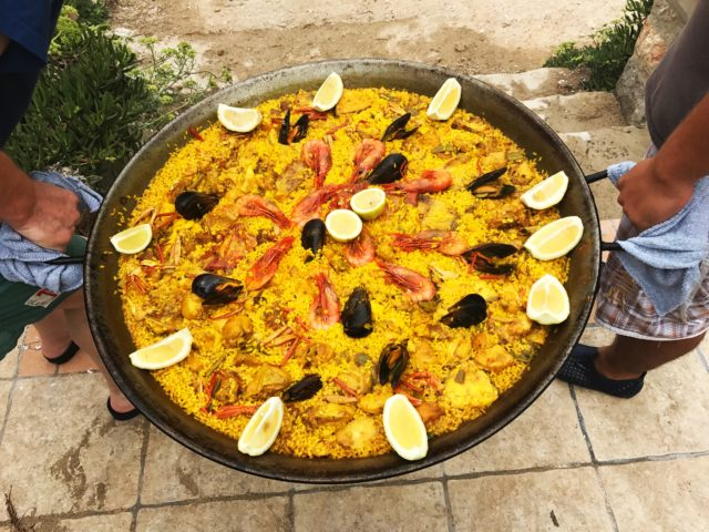 Carrying Pan Of Spanish Paella