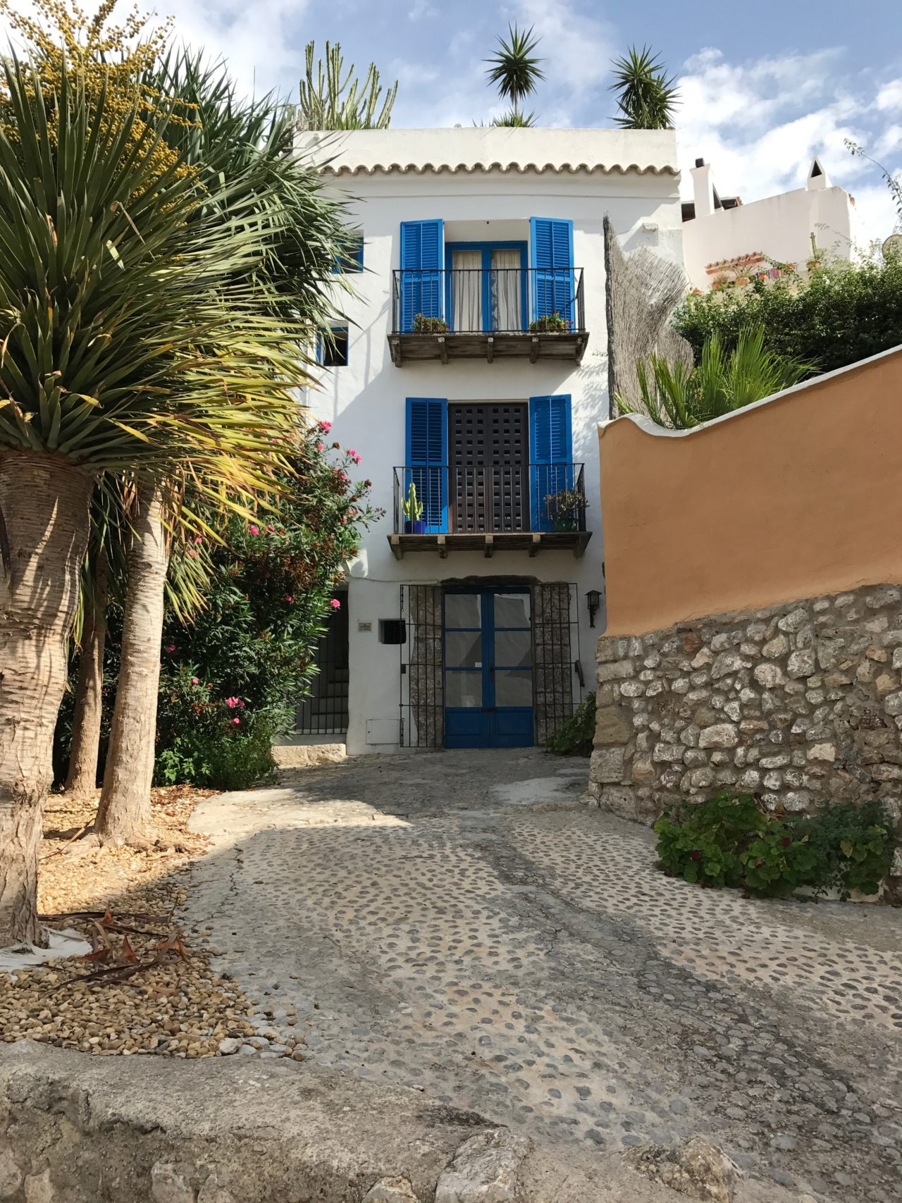 Apartment Building In A Narrow Alley With Cobblestone