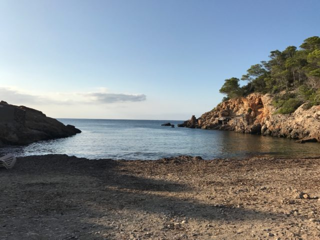 Ibiza Beach Cove With Mountains On Both Sides