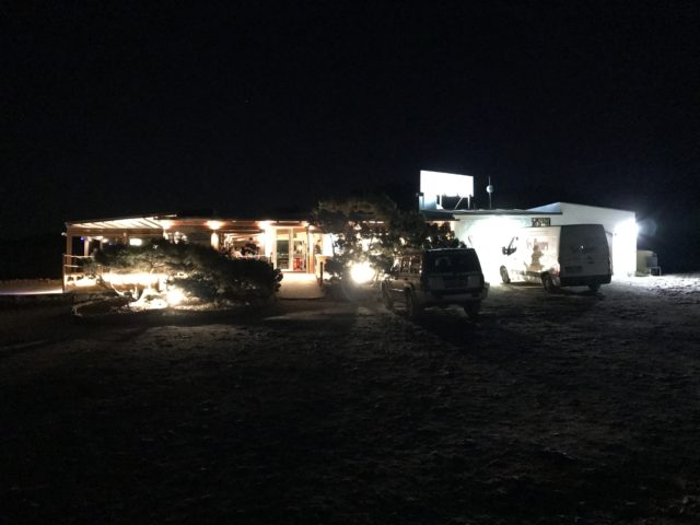 Outside Beach Front Restaurant With Lights At Night
