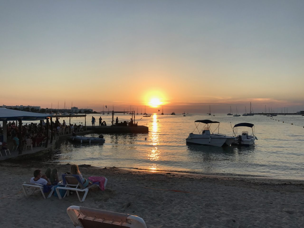 Beach Restaurant With People Watching The Sunset