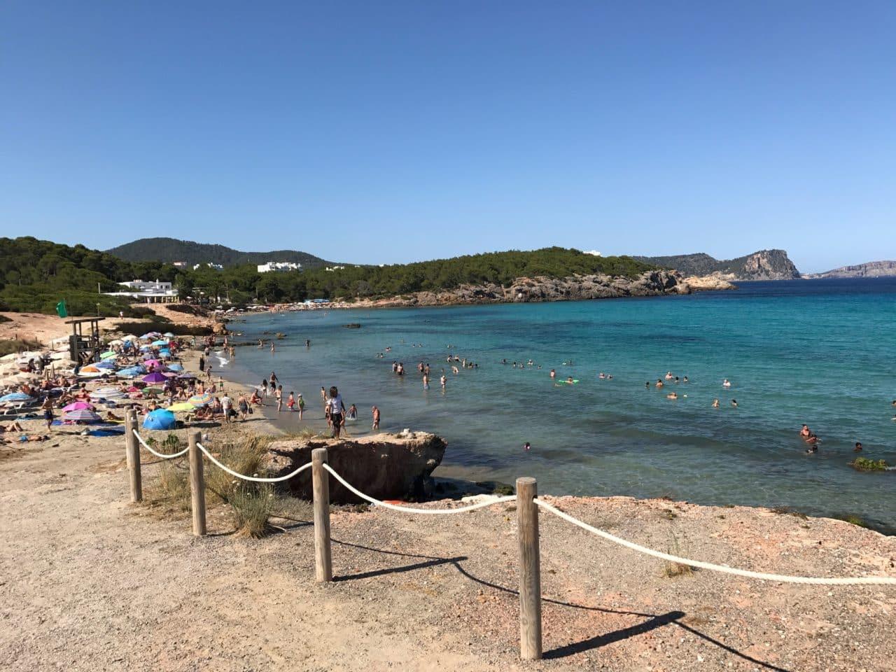 People Sunbathing On A Tropical Beach In Spain