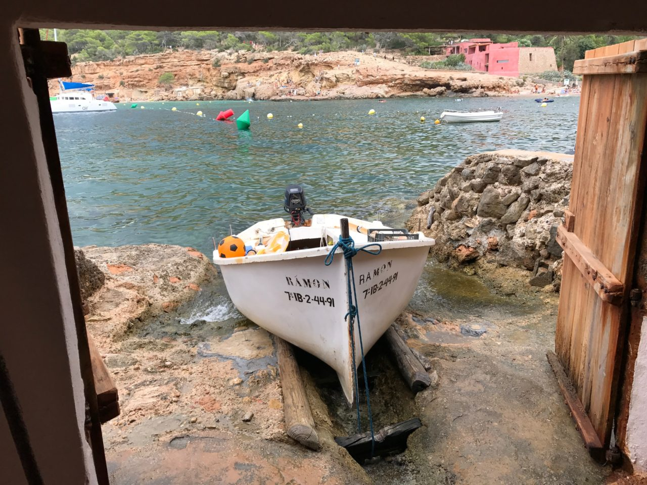 Boat At The Entrence Of A Cave With Doors Open