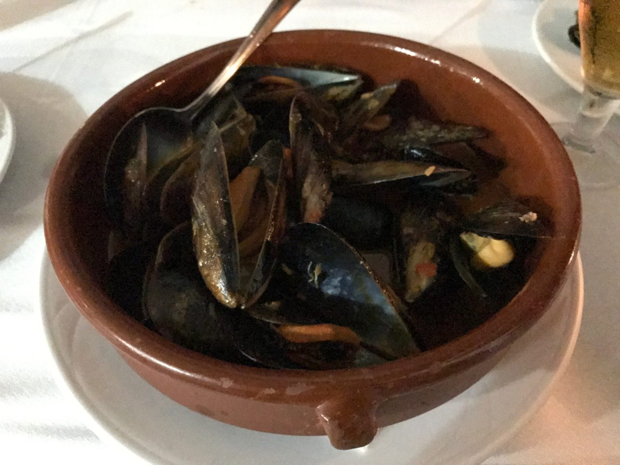 Bowl Of Cooked Clams And A Spoon