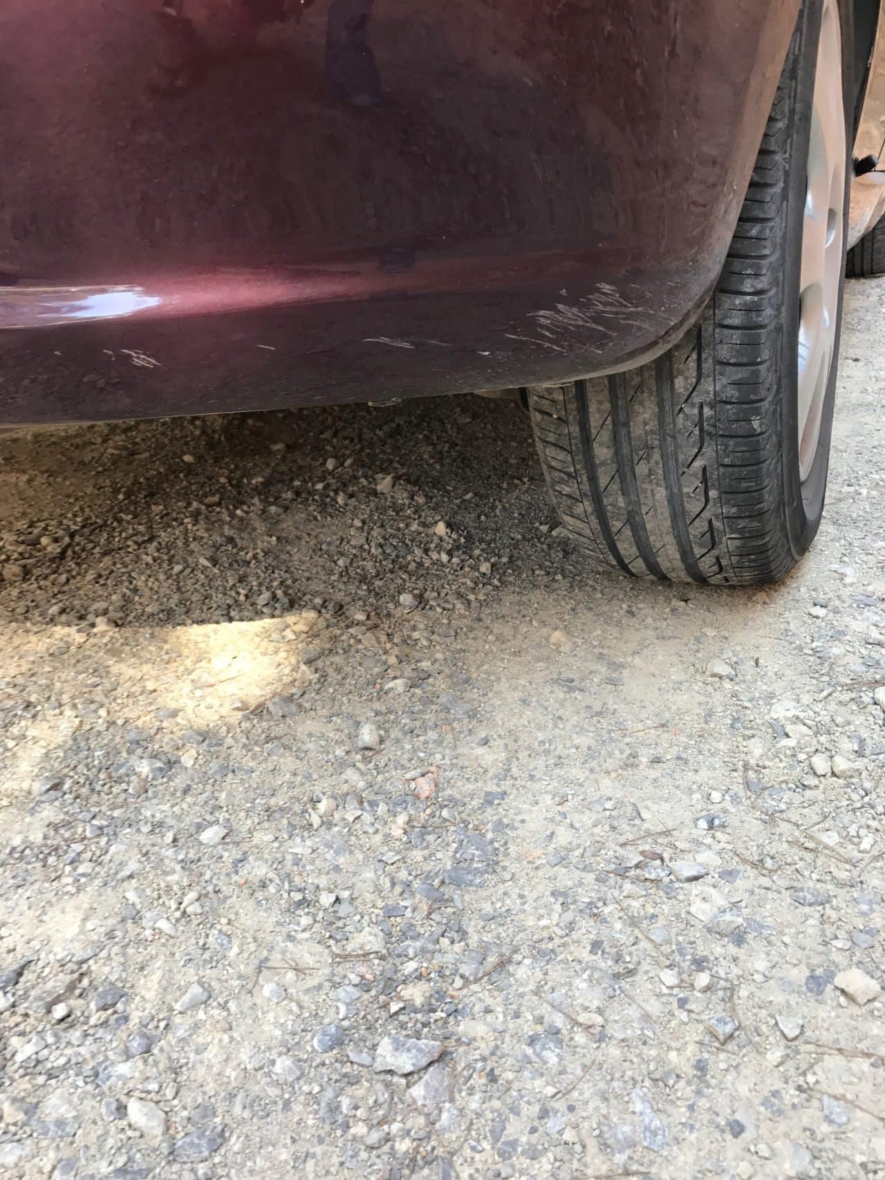 Dusty Car With Scrape Damage In The Rear