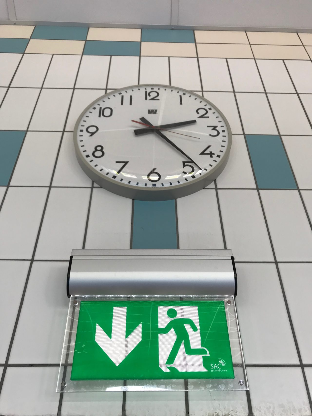 Ermegency Sign On A Wall With A Clock