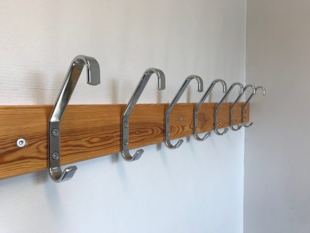 Lined Chrome Clothes Hangers In Dressing Room