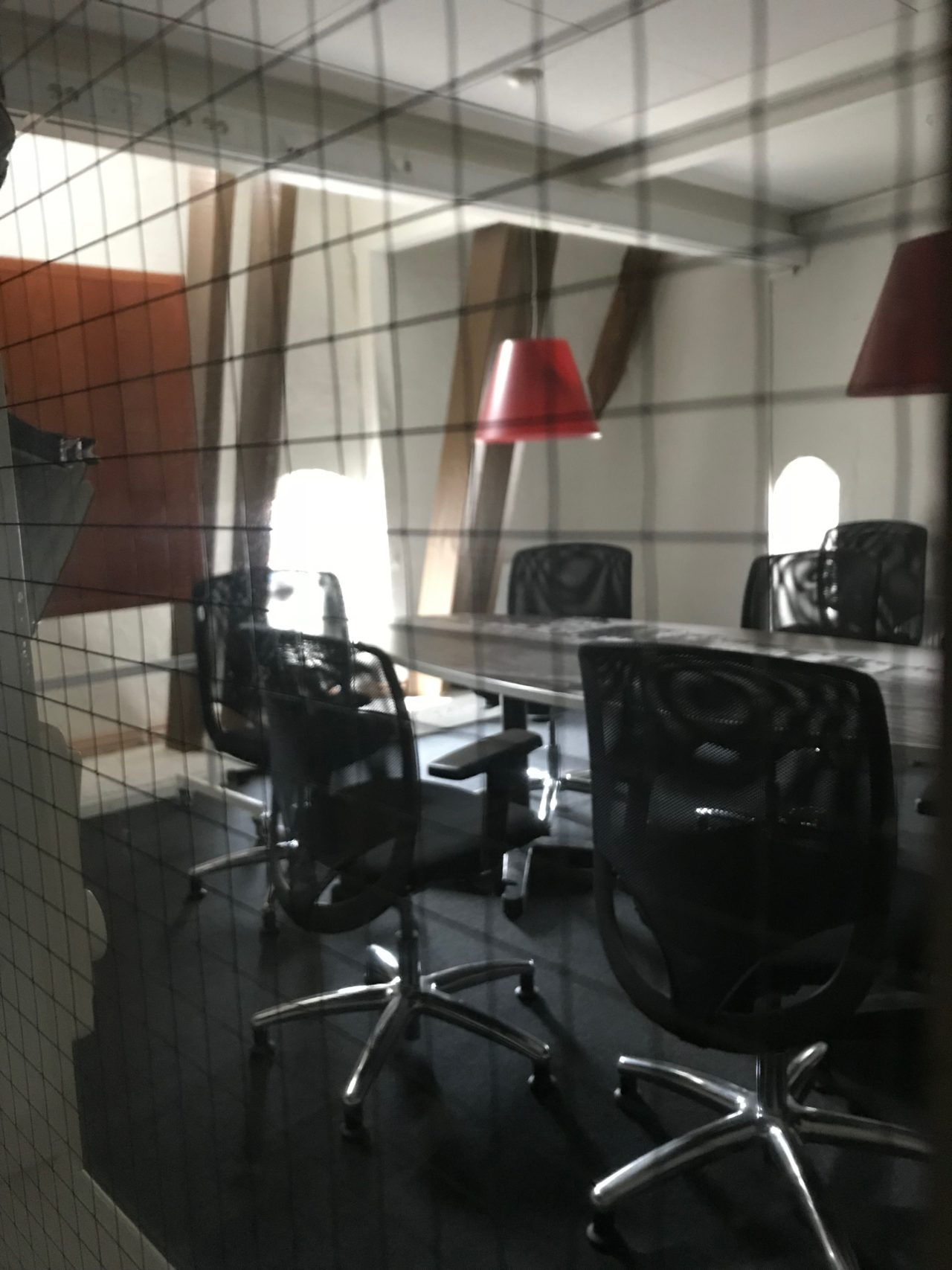 Locked Private Conference Room With Table And Chairs