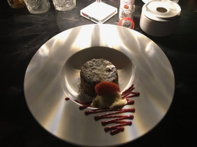 Chocolate Dessert On A Plate With Jam And Strawberries