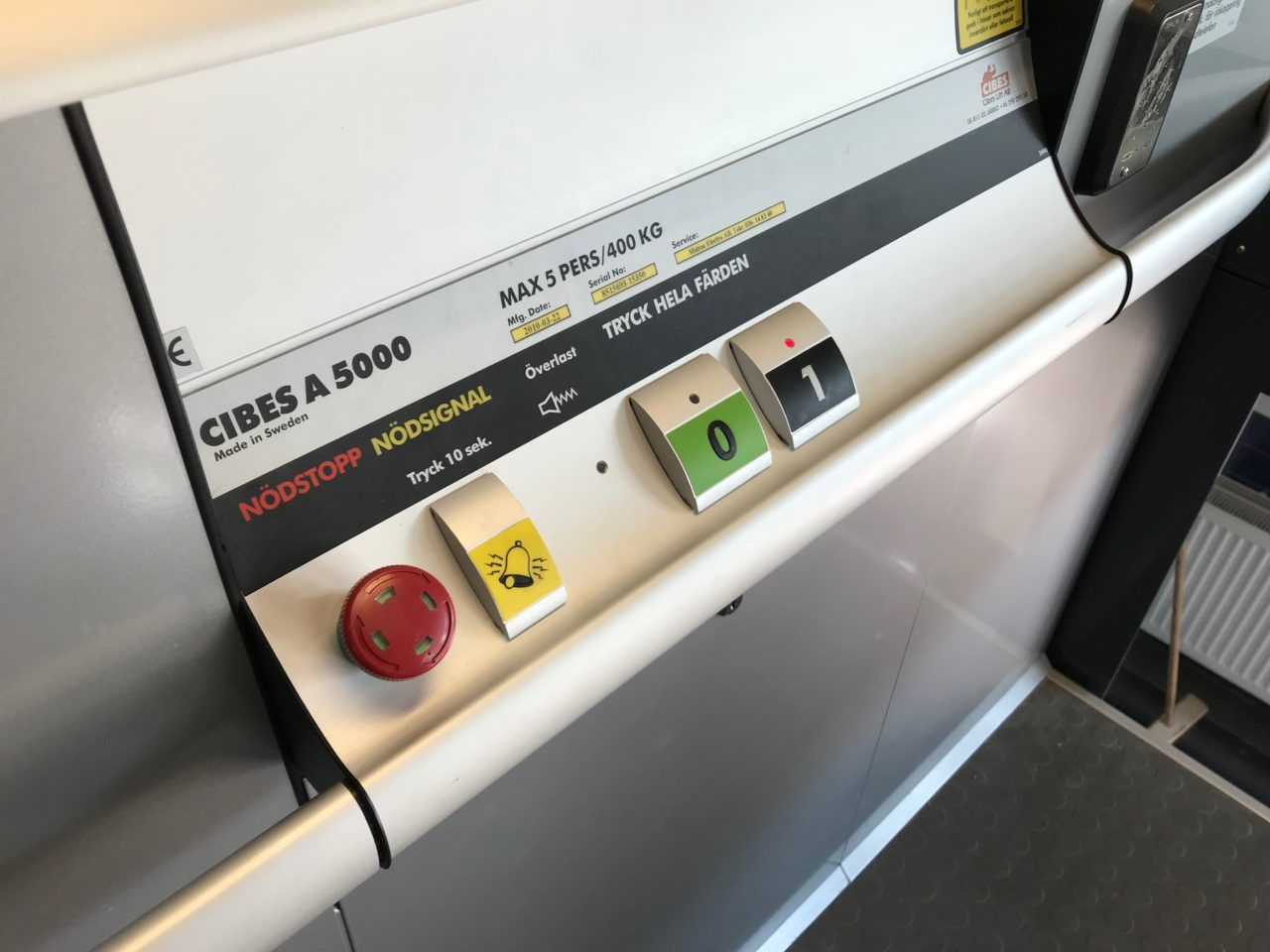 Elevator Control Buttons On A Dashboard Rail