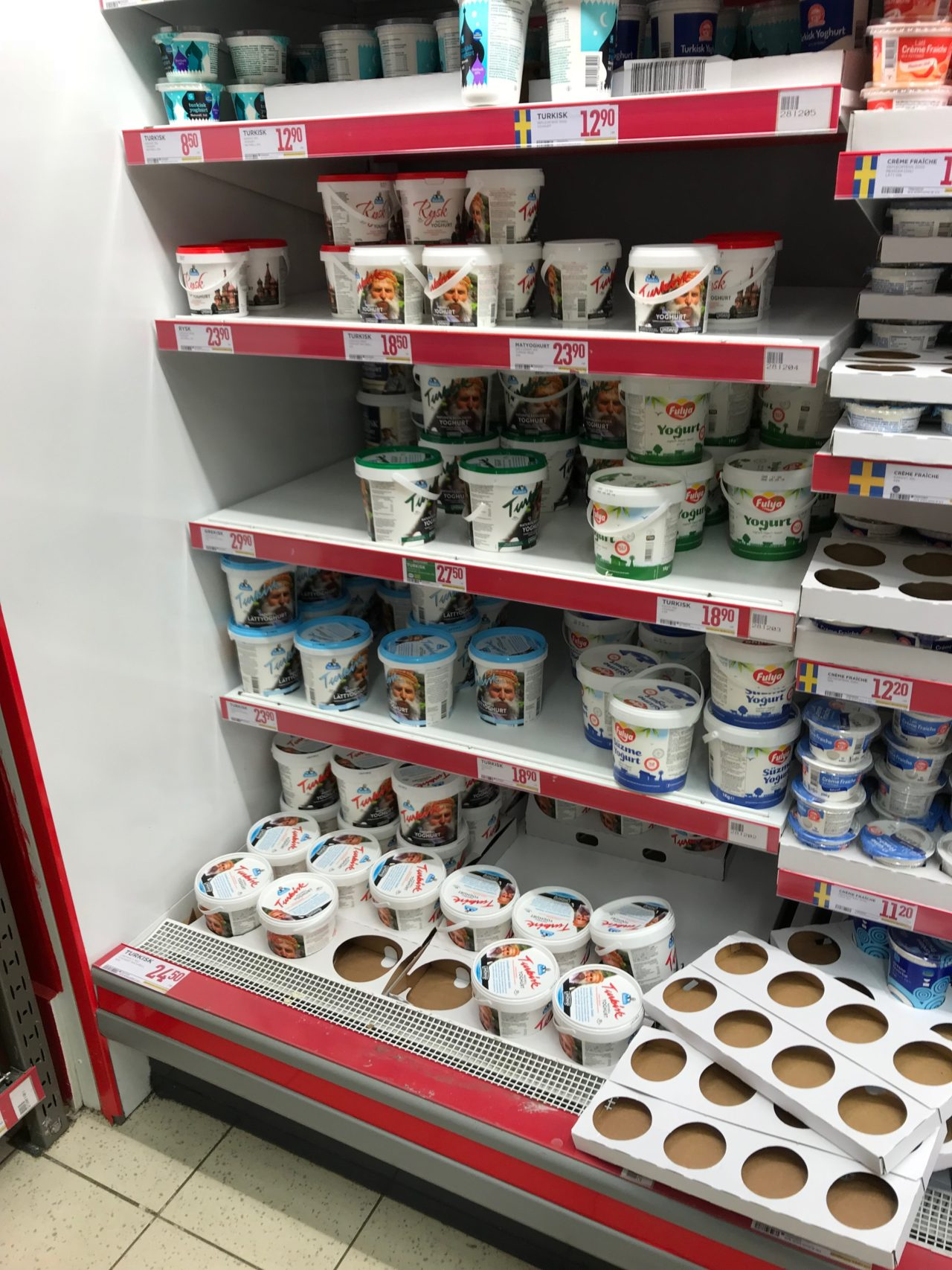Bucket Dairy Products Stacked On Store Shelves