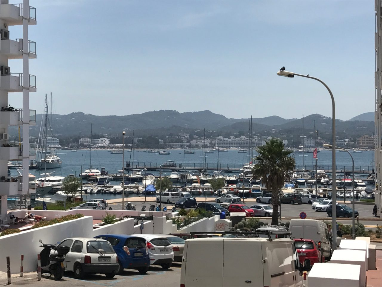 Harbor With Boats And Cars In Front Of It