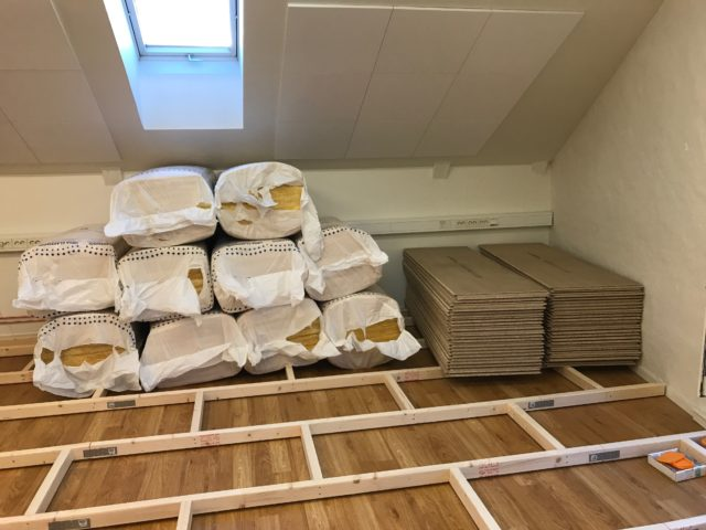 Bags Of Isolation And Construction Joists And Flooring Stacked On Floor