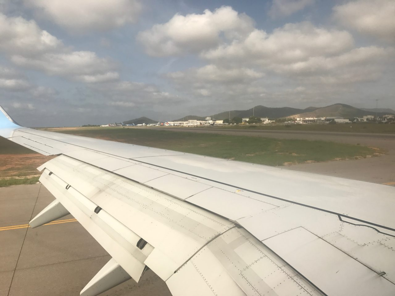 Voew Of Wing Of A Plane Landing Or Taking Off On Runway