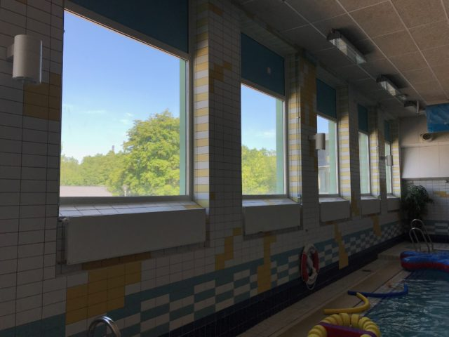 Large Lined Up Windows In Inhouse Pool Area With Toys