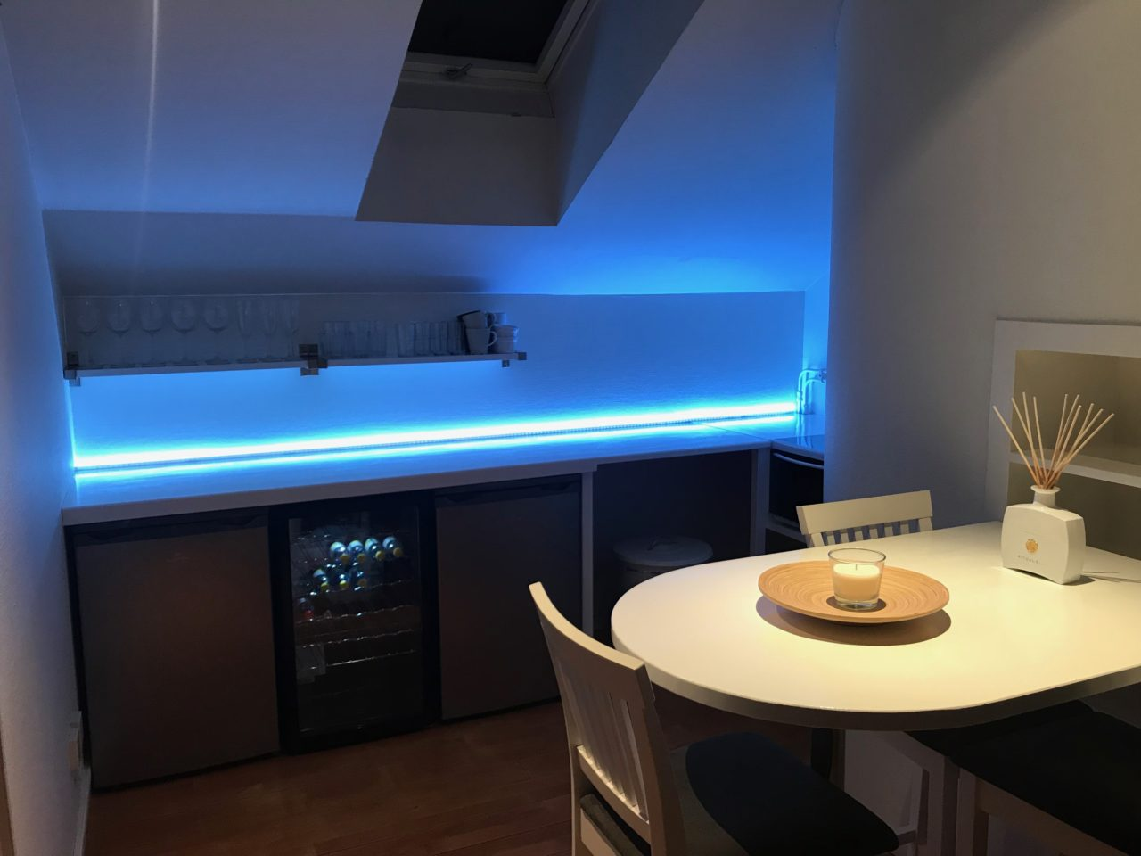 LED Lit Penthouse Kitchen With A Table And Window