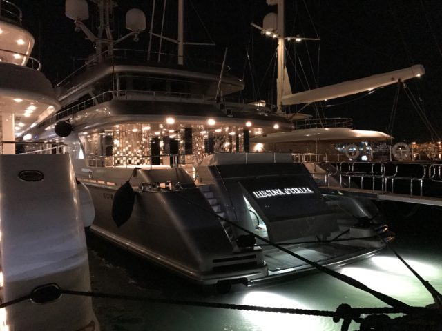 Luxury Yacht Docked At Harbor With Lights