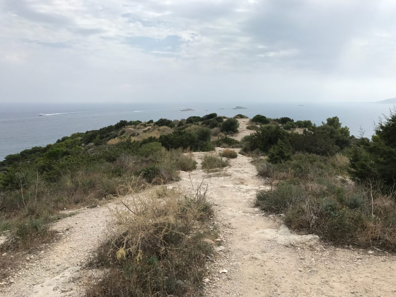 Mountain Dirt Pathway With Brush And Grass By The Ocean