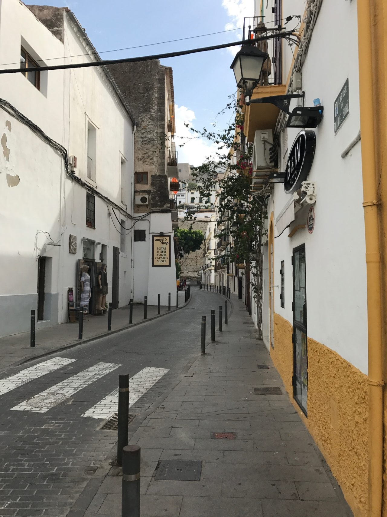 Narrow Alley Street With A Small Shop And Pedestrian Crossing