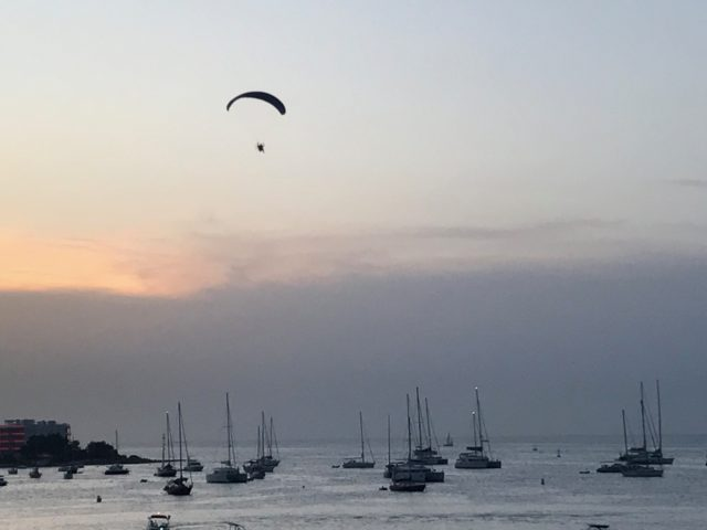 Paraglider Flying In The Sky At Cloudy Sunset