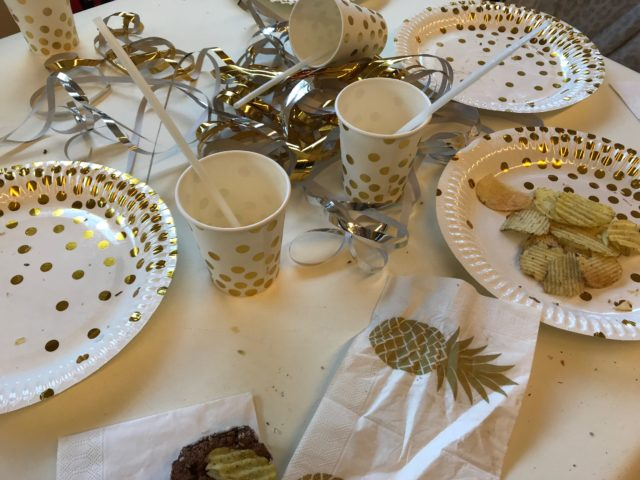 Party Table Mess With Cups, Plates And Napkins