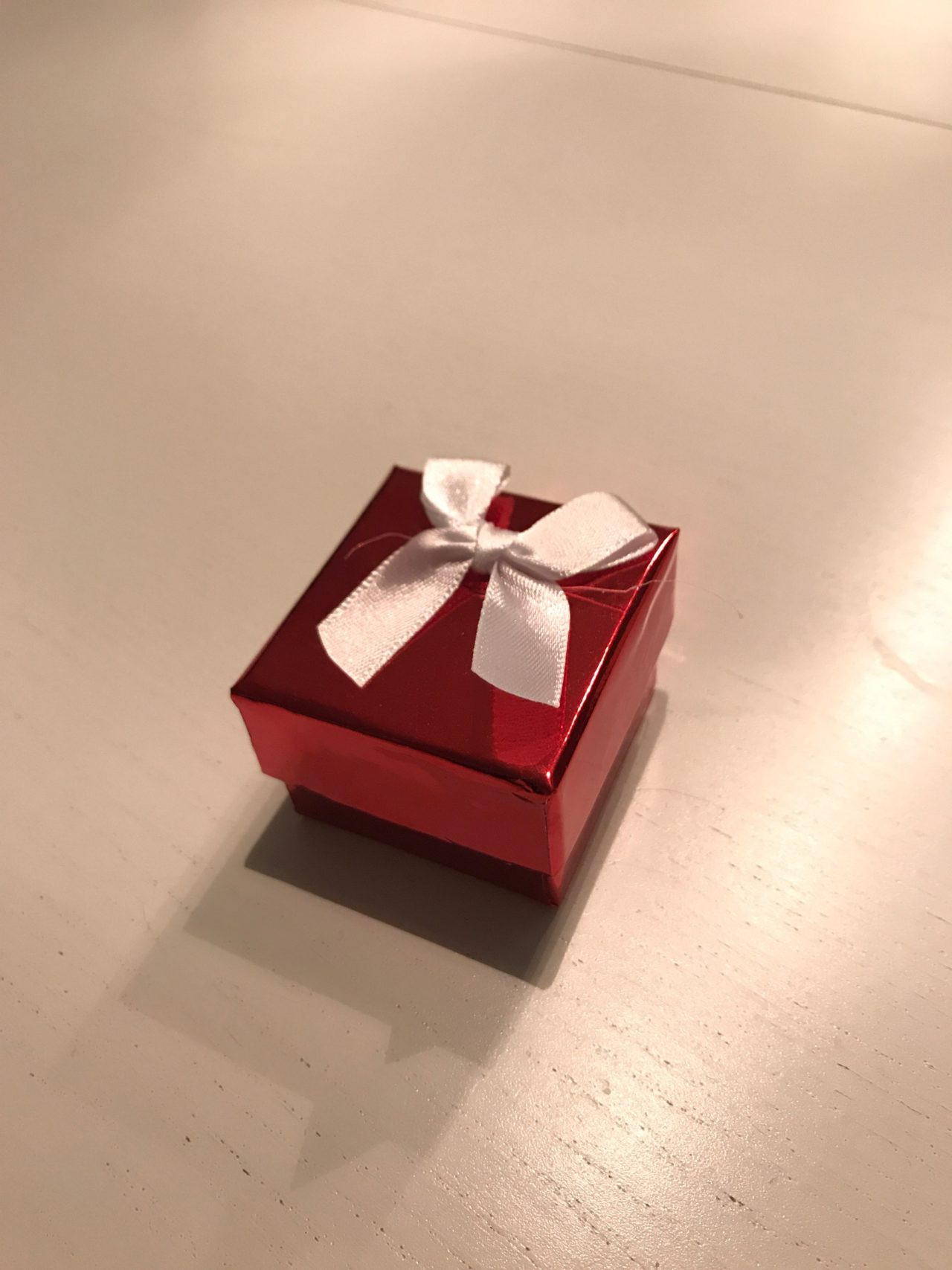 Small Red Gift Box With A White Bow