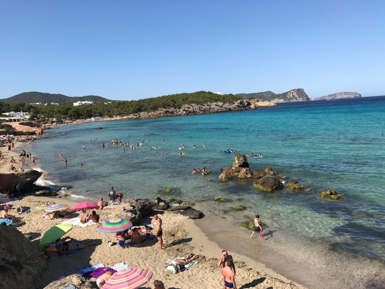Public Beach In Ibiza In Spain Full Of People