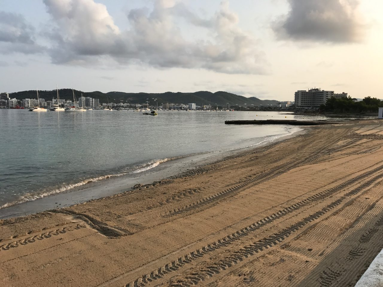 Raked Beach And City View In The Morning