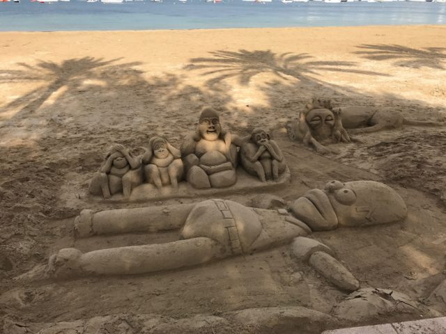 Simpsons And Monkey Sand Sculpture Art On Beach