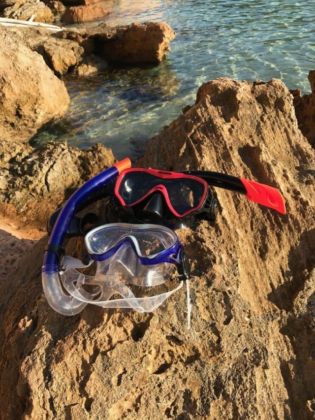 Snorking Diving Gear On Ocean Side Rocks