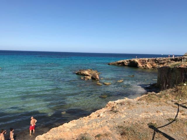 Ocean Rock Swimmers In Cove In Spain