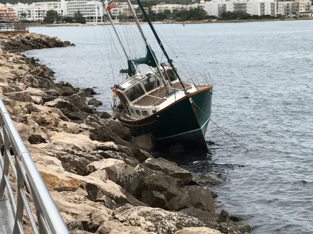 Stranded Boat On A Pier Bank In A Harbor