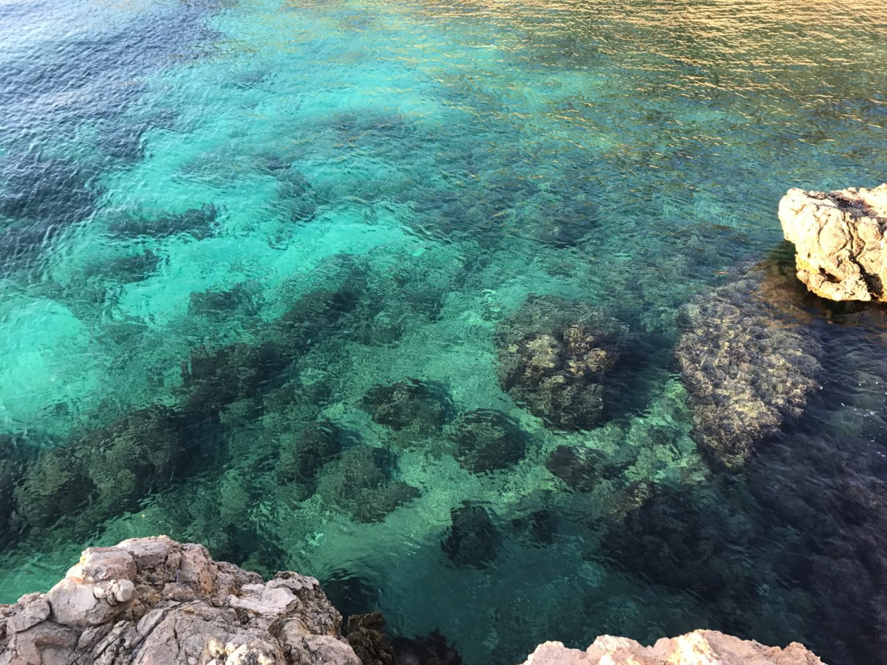 Tropical Ocean Clear Water With Rocks