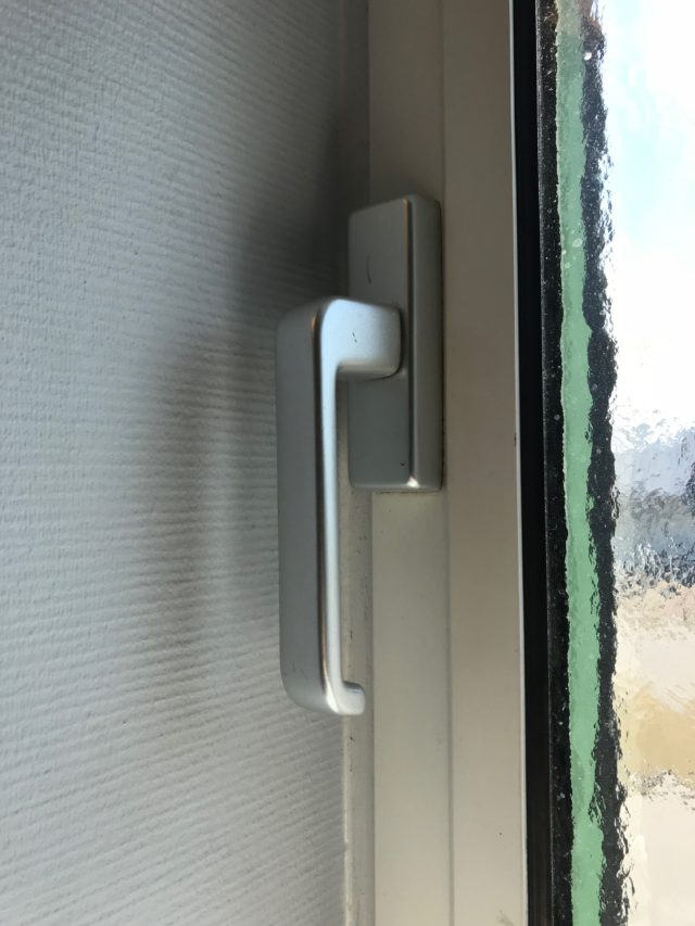 Modern Chrome Window Handle On Closed Home Window
