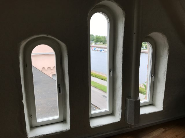 Three Windows Overlooking River With Boats