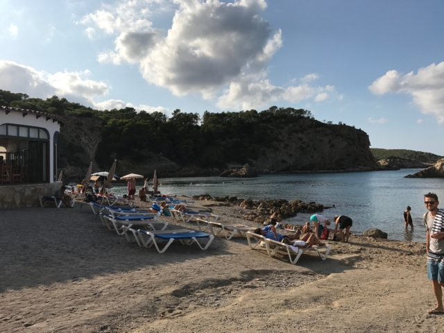 Sunbeds On A Gravel Beach With People