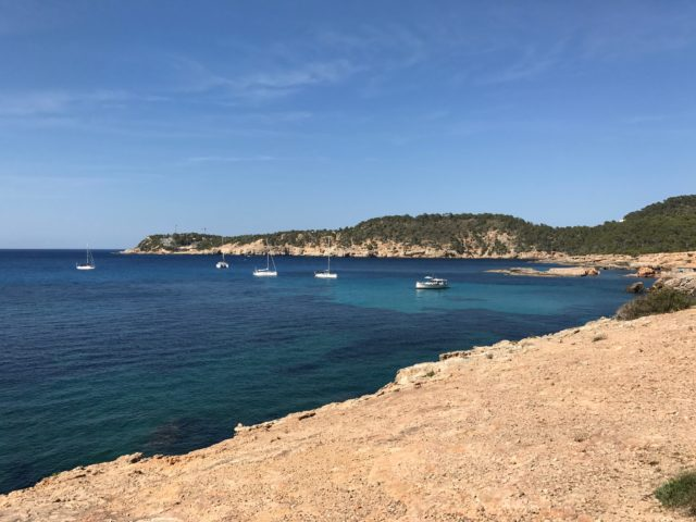 Exotic Cove With Blue Sky And Boats In Ibiza