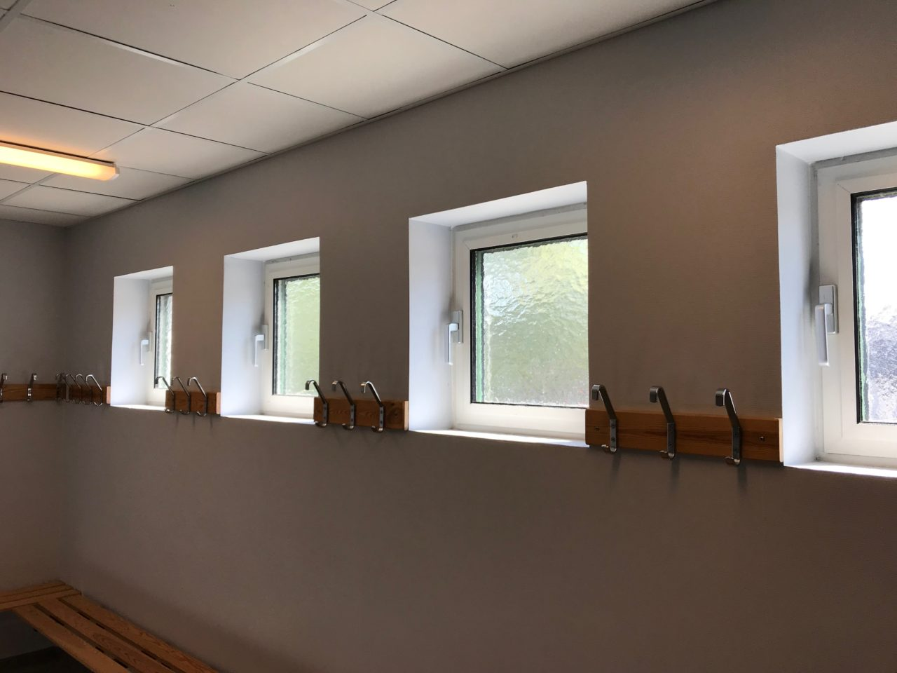 Small Windows In Dressing Room With Coat Hangers