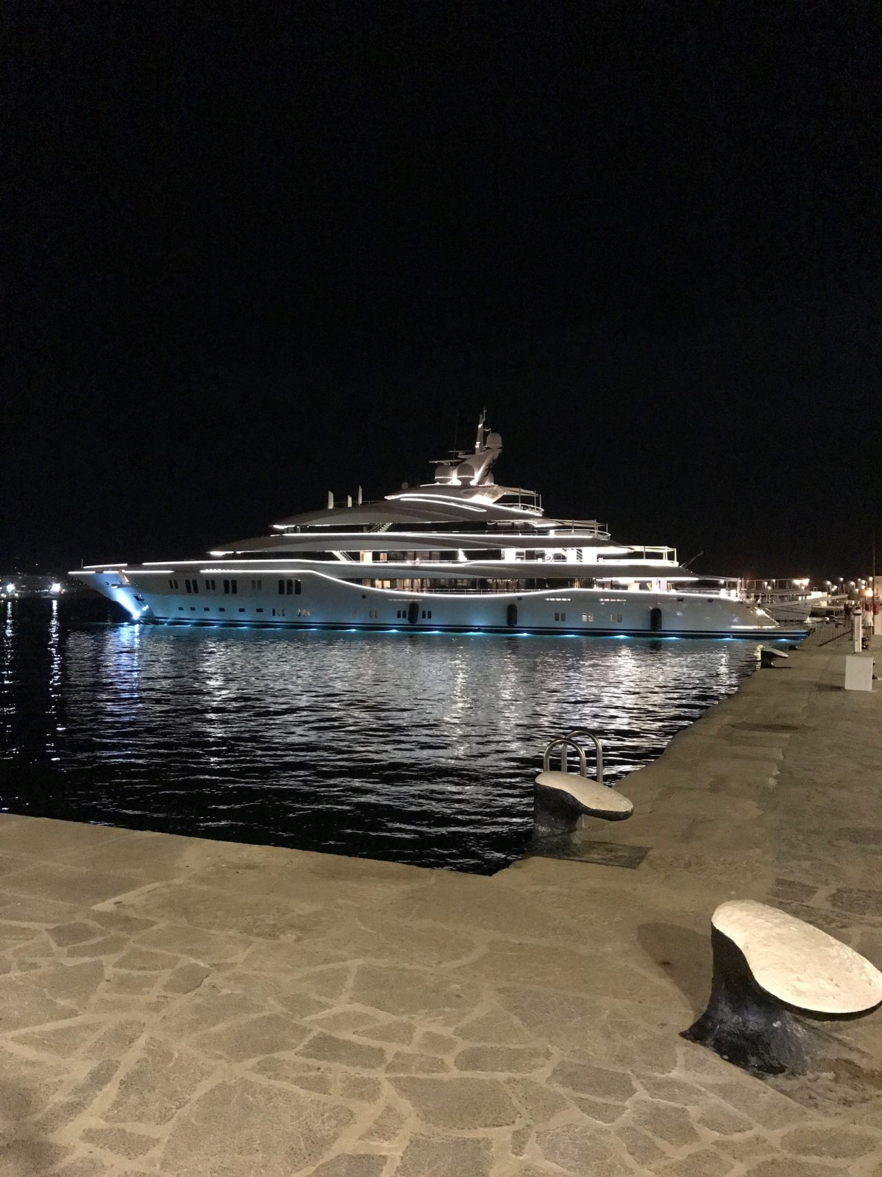 Luxury Yacht With Water Line Lights Docked In City