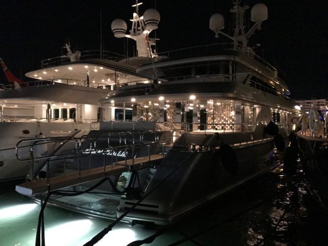 Black Luxury Yach With Lights By Dock