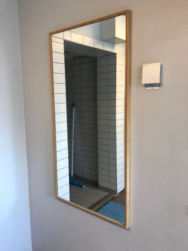 Wooden Wall Mirror In Locker Room