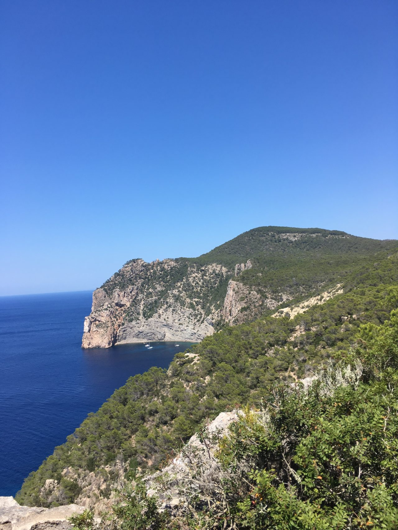 Mountain View Of Coastal Cove With Blue Sky