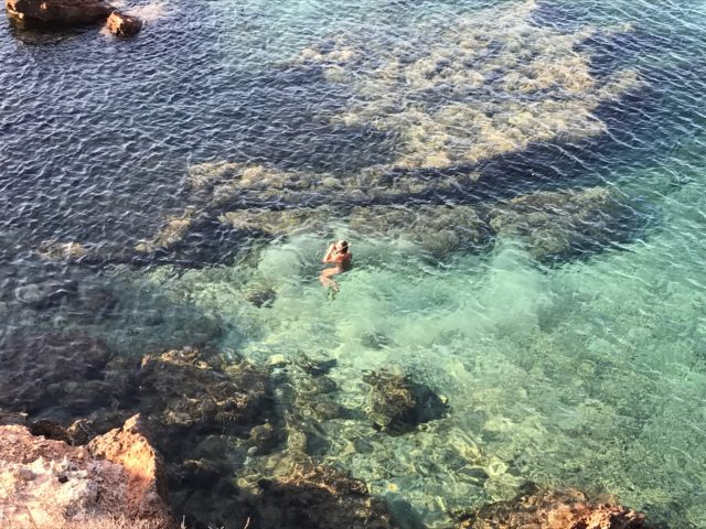 People Swimming In Tropical Water In Ibiza