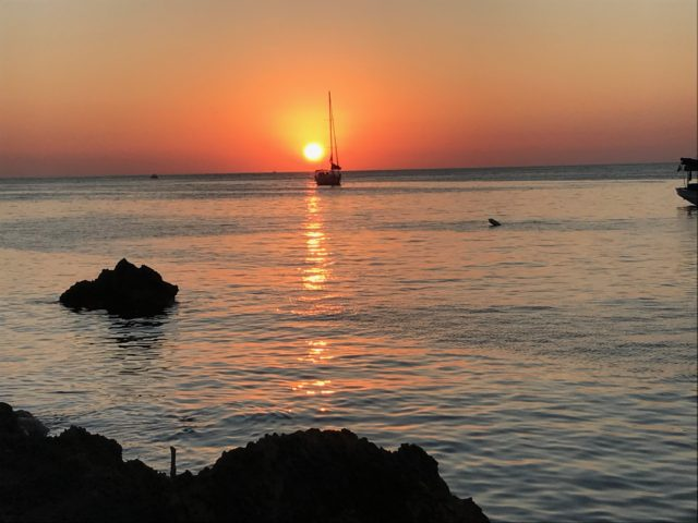 Orange Ocean Sunset With Sailing Boat