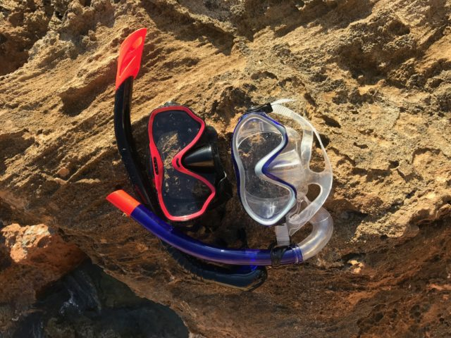 Diving Goggles And Gear On Cliff