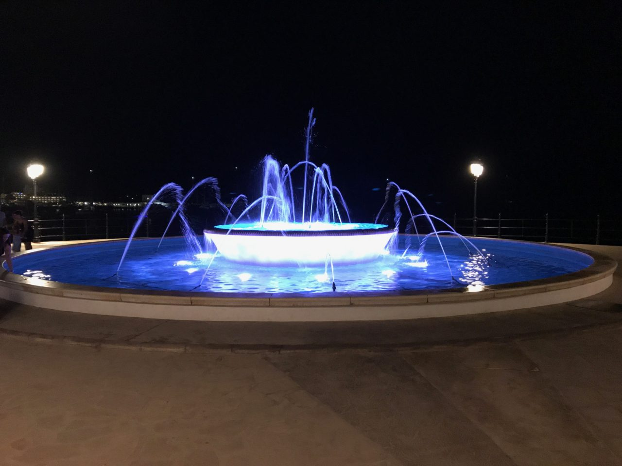 Blue LED Lit Water Fountain At Night