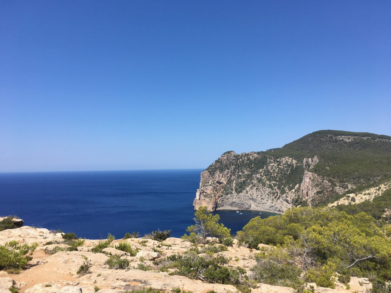 Mountain View Of Island Coast And Ocean With Clear Blue Sky