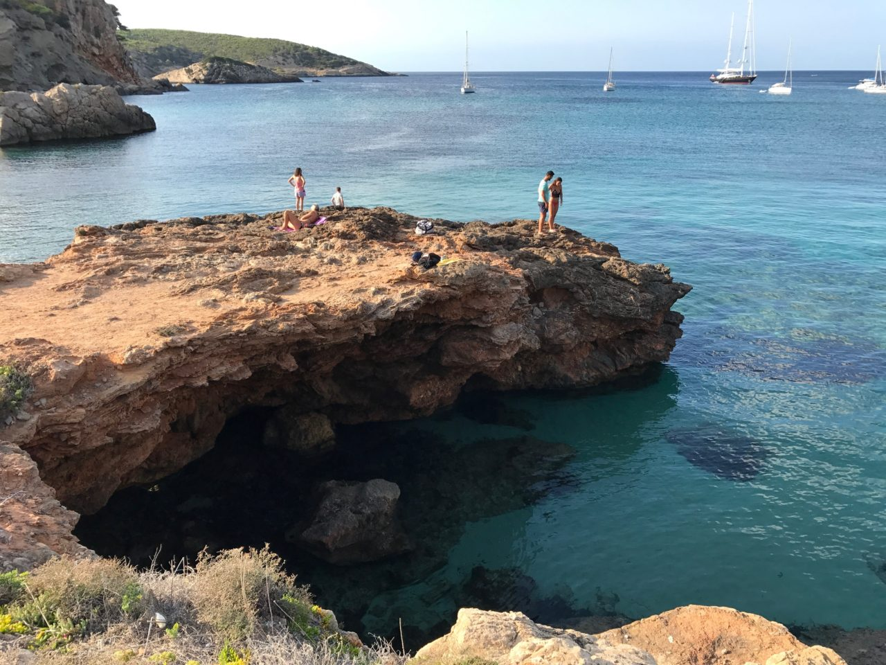 Cliff Divers On Tropical Coastal Cliff