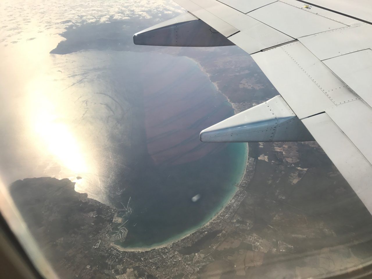 Airplane Window View Of Ibiza Coastal Line