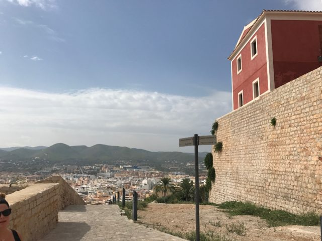 Fortress Stone Pathway With Red House And Rock Walls With City View